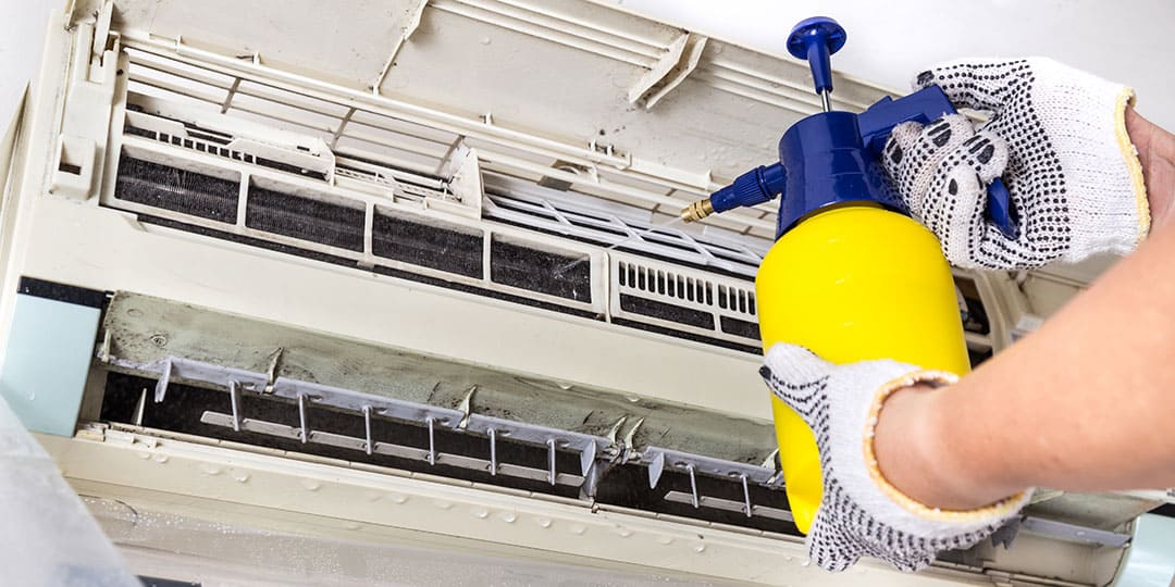 Cleaning an AC Coil using a cleaner and a sprayer